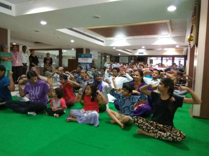 pic 2-yoga enthusiasts performing