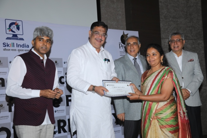 (From L-R) A student being conferred her certificate by Mr. Muralidhar Halappa, Mr. Tanveer Sait, Mr. Irfan Razack & Mr. Noaman Razack
