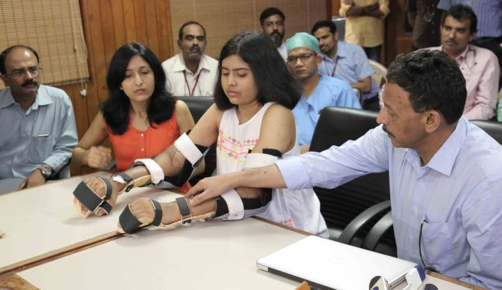 Pix 2 - Hand transplant recipient Shreya flanked by her mother and Dr. S...